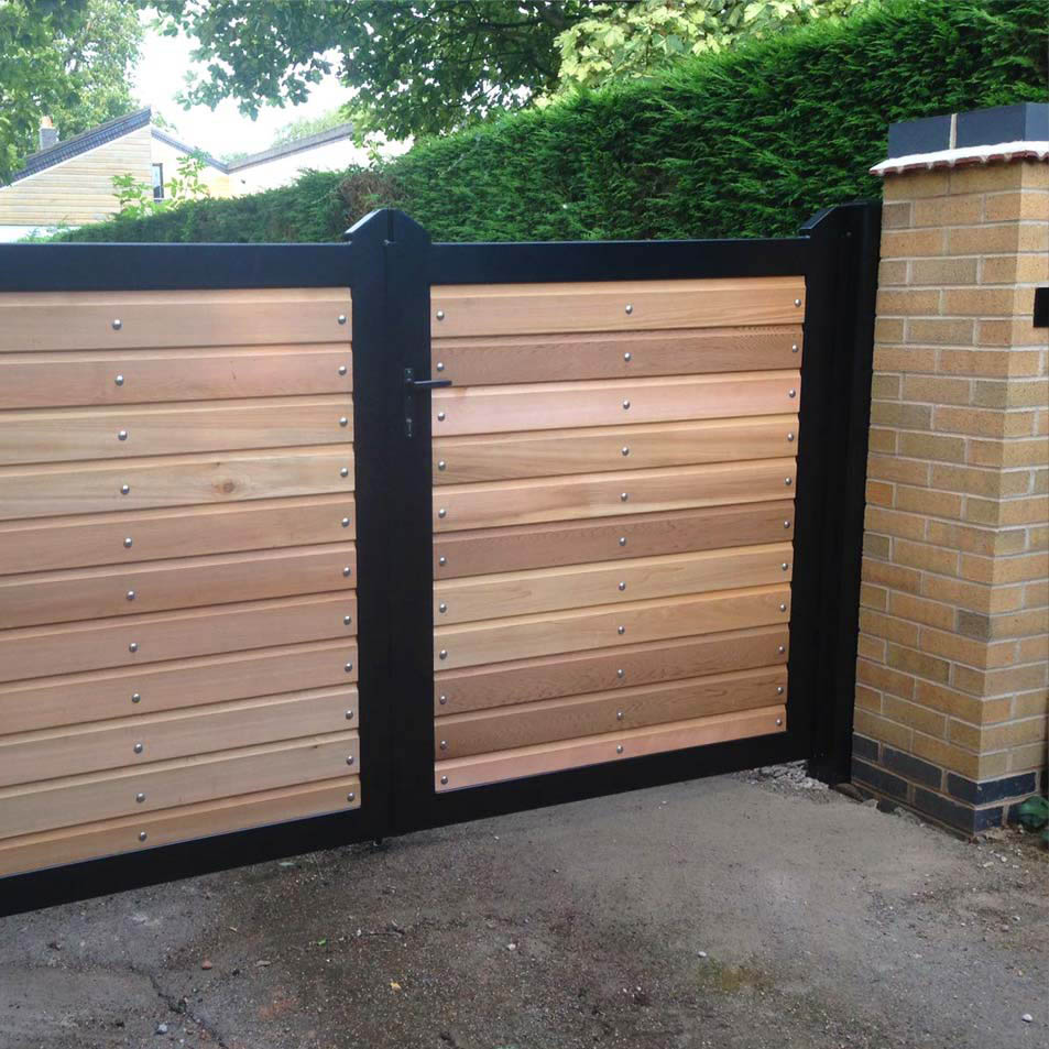 Metal wood lined driveway gates ironcraft for Ready made driveway gates